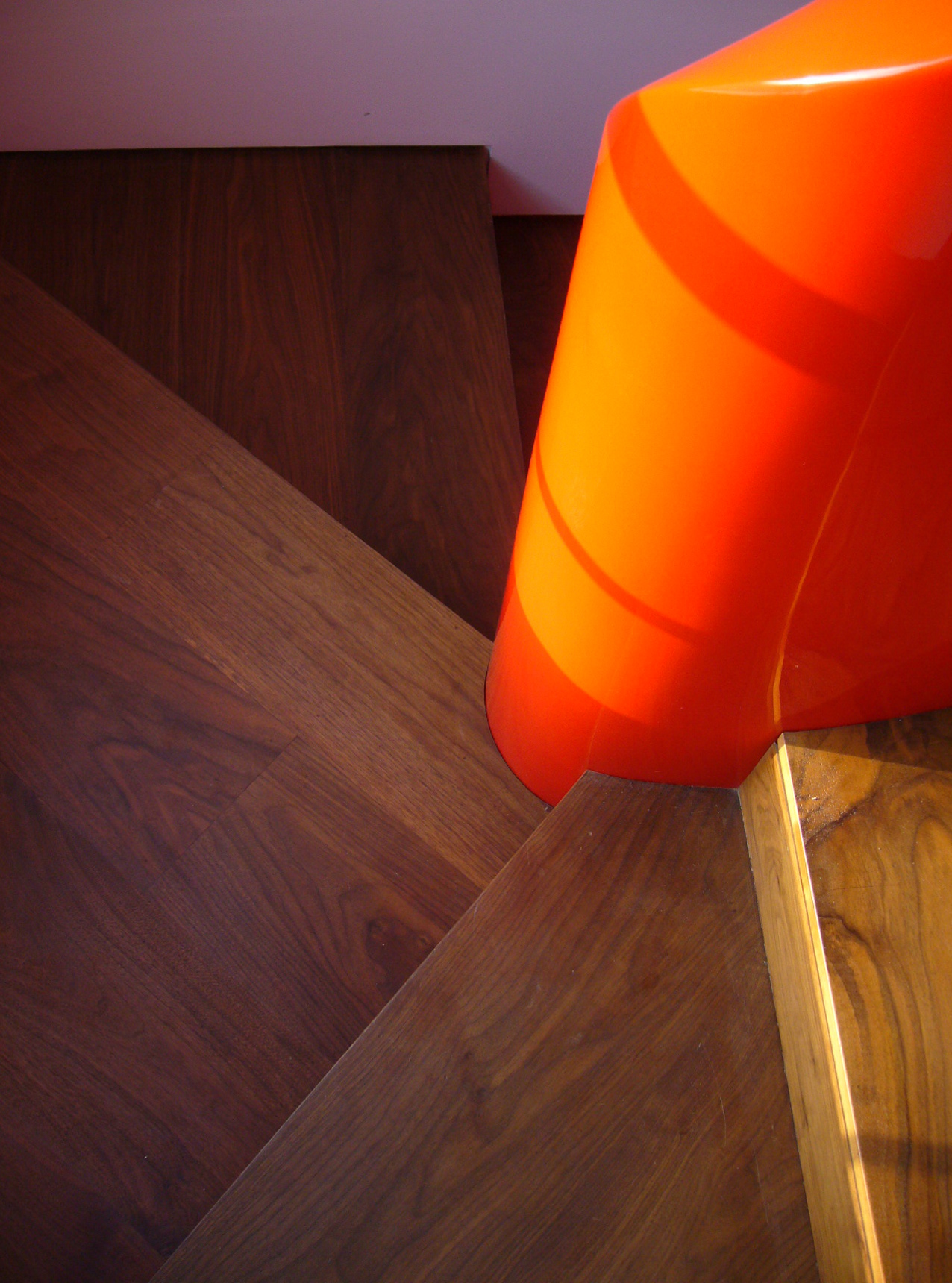 American Black Walnut Staircase Close up with orange spindle