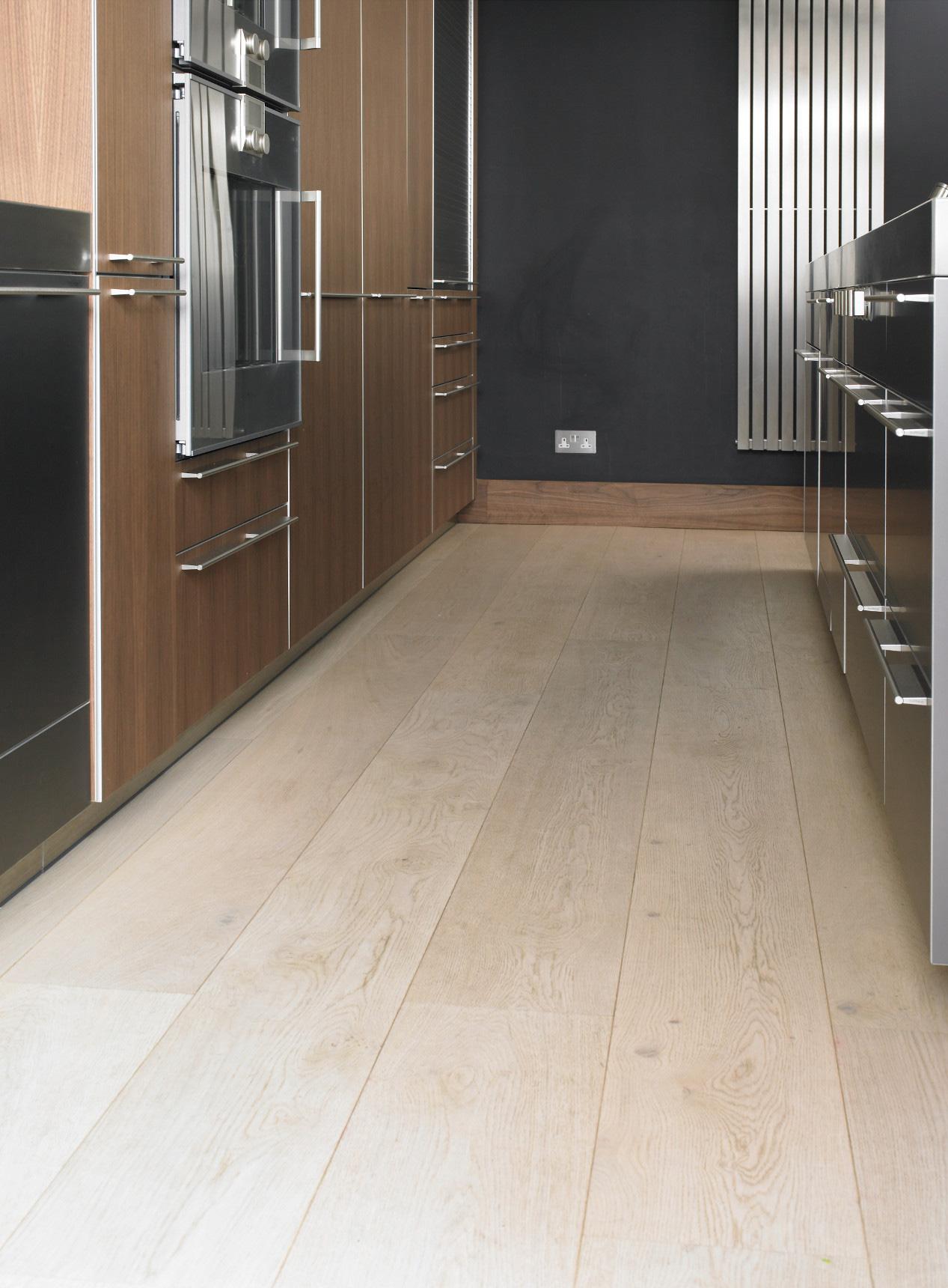 Oak polar white plank in kitchen with wall radiator