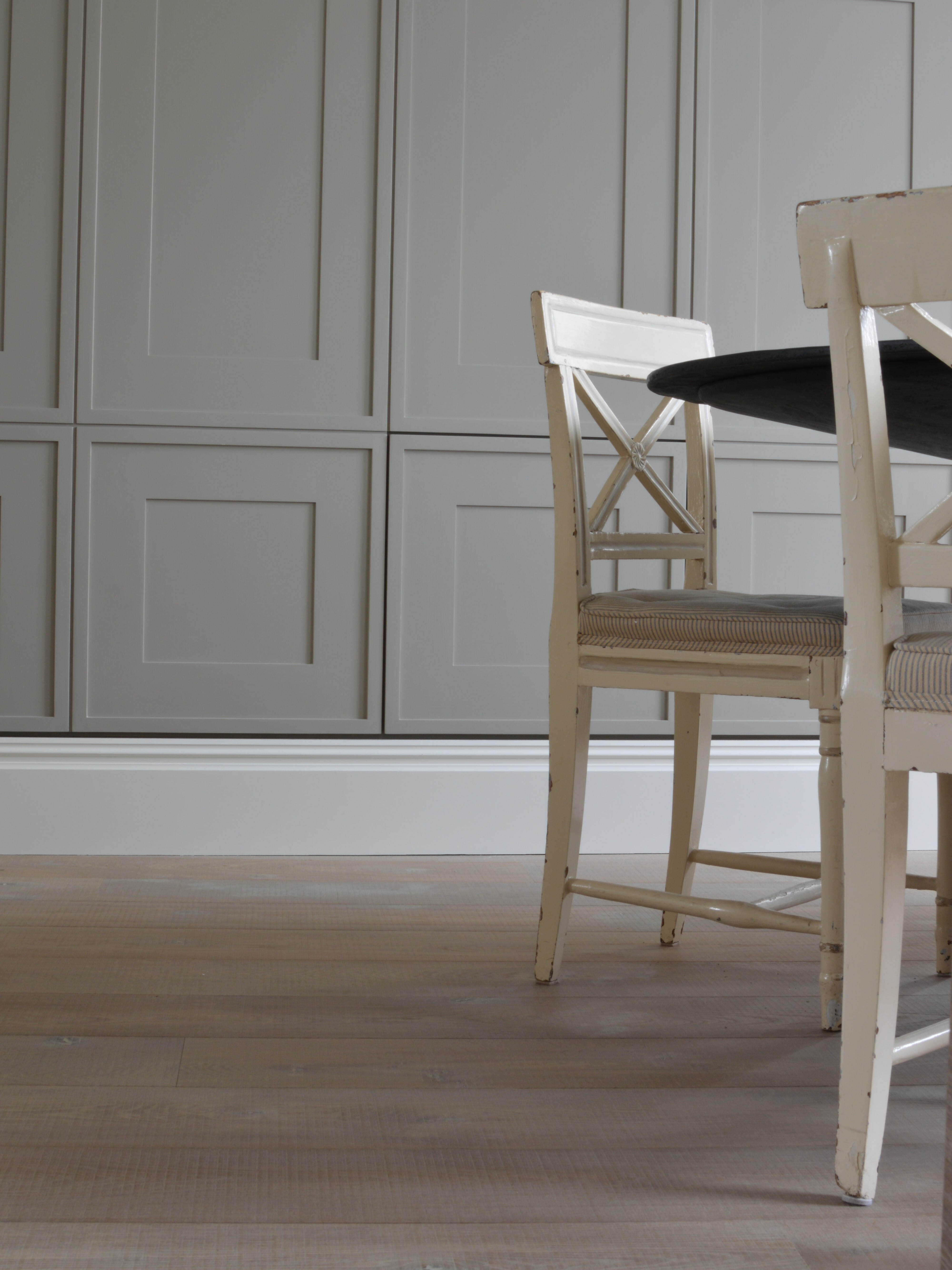 Oak tate bute flooring in dingroom with grey panelling