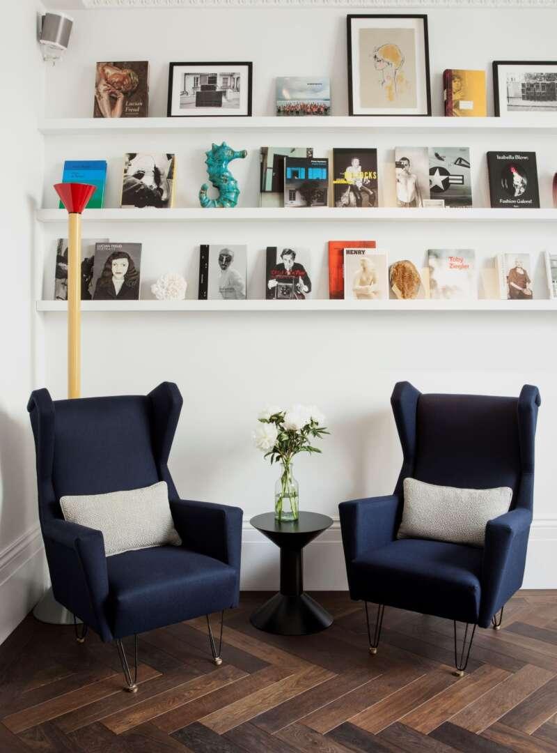 Oak landmark montacute herringbone floor in Library at the Laslett Hotel with blue chairs photo by Ana Cuba