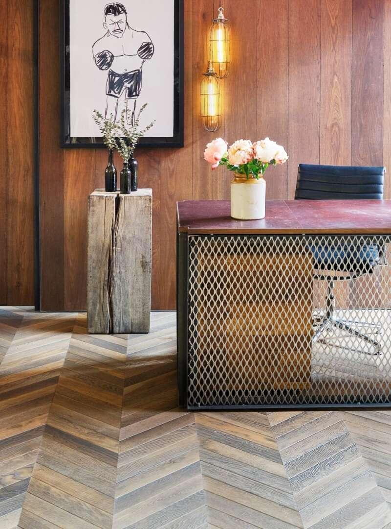 Oak landmark scotney in chevron parquet pattern with desk and print by stephen anthony davids