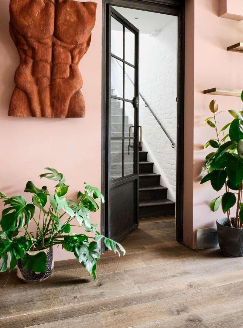 Oak landmark scotney wide board engineered flooring in rustic reclaimed look with steel doors oak pedestals and bronze sculpture