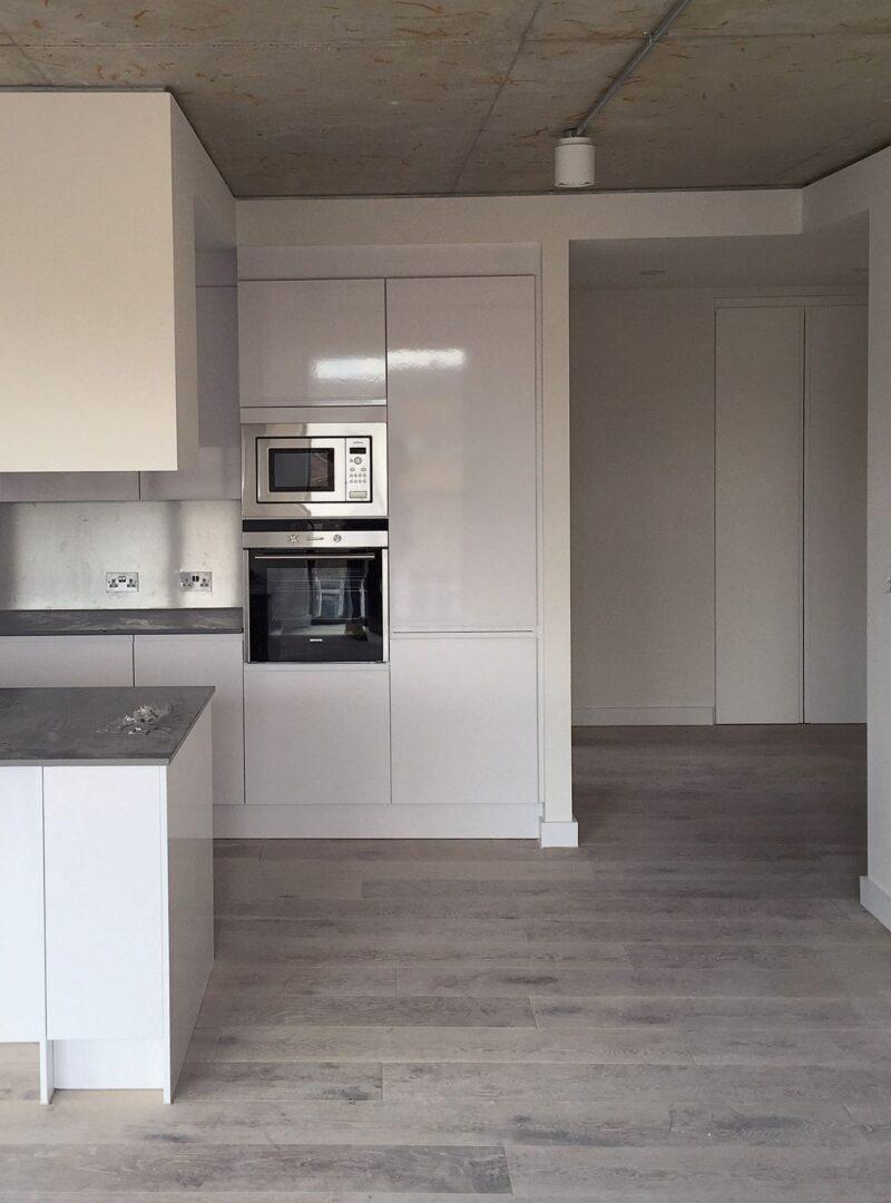 Solid floor grey textured oak citadel open plan kitchen