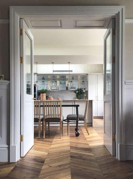 Oak landmark dalton chevron in leinster square looking through doors into kitchen