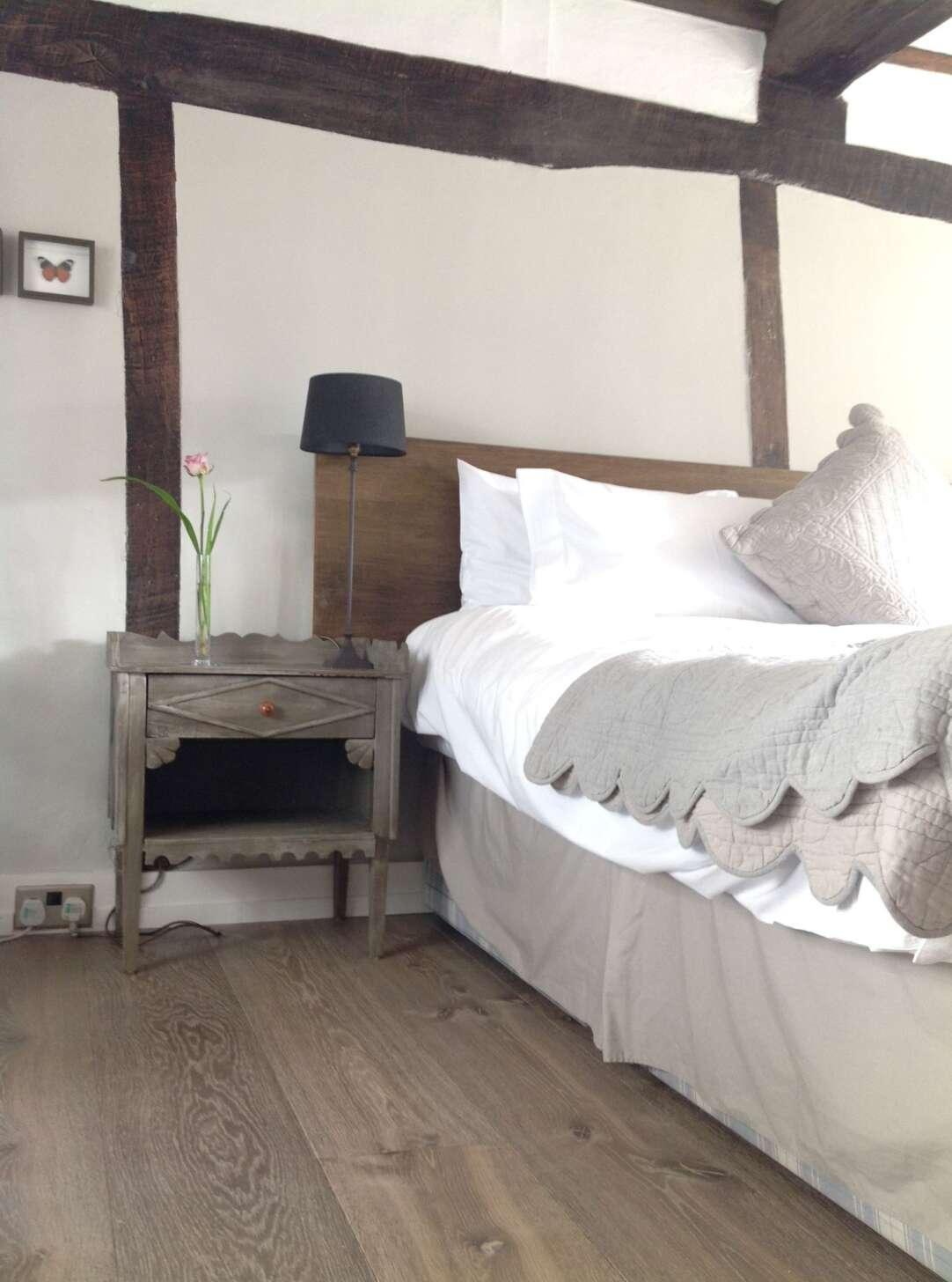 Oak dyrham wide board floor in bedroom swanhouse hastings