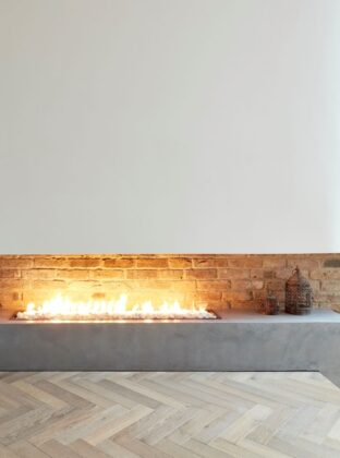 M Clayton tate bute herringbone floor with modern fire place