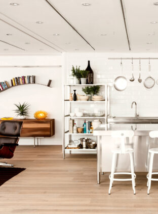Oak tate skye plank in the conran store with open kitchen shelving and a eames lounge chair