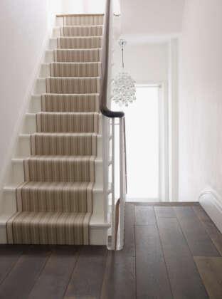 Oak Landmark Killerton plank dark timber floor on landing with stair-runner