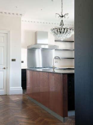 Oak landmark tatton herringbone in kitchen with copper clad island
