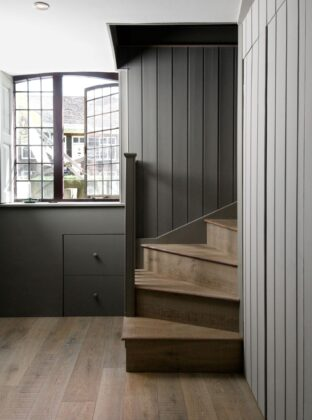 Tate bute flooring with timberclad staircase and grey paneling 1