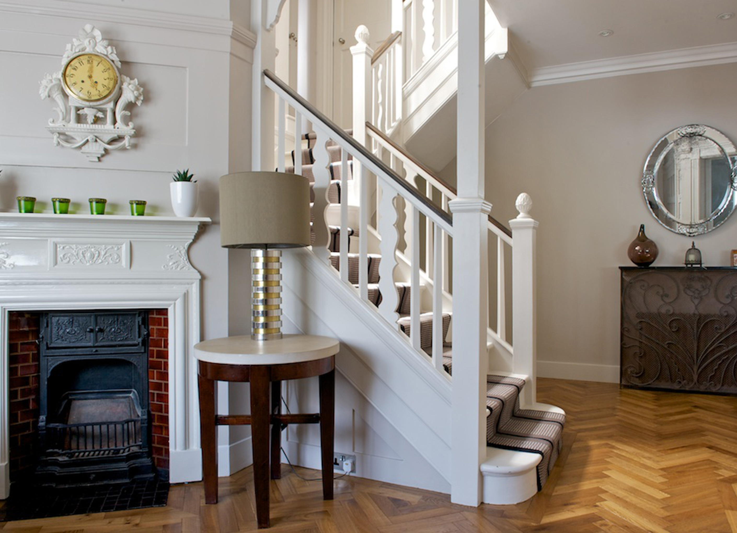 oak landmark dalton herringbone with staircase and traditional fireplace and mirror