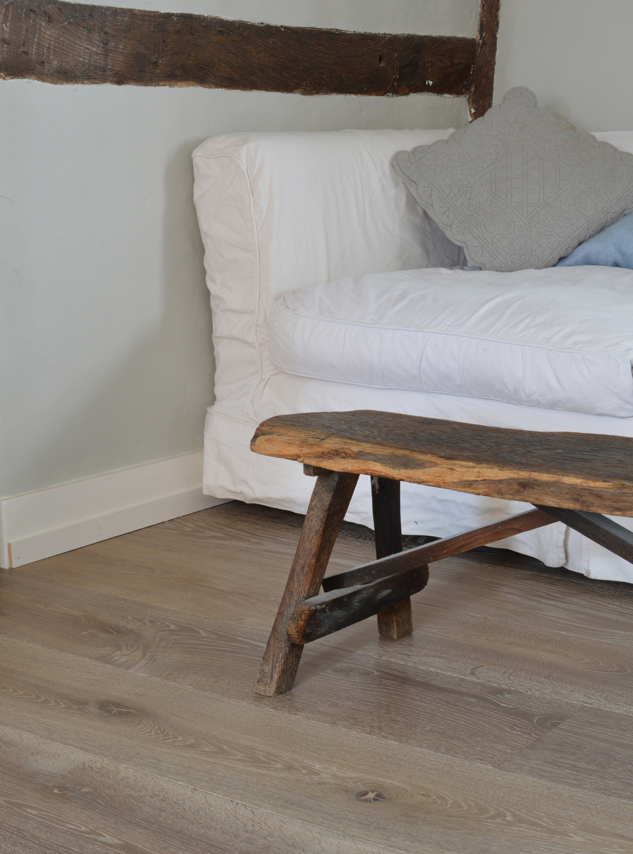 Oak landmark dyrham planks with a white sofa and wooden bench