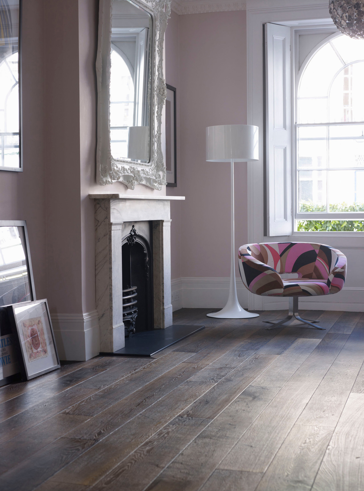 Oak Landmark Killerton plank dark brown engineered floor with pink walls fireplace and pink chair