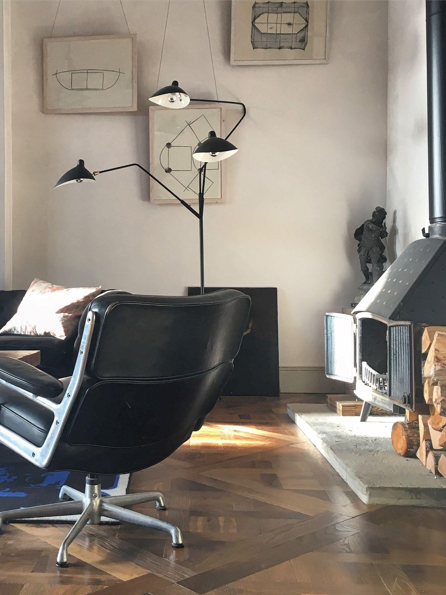 Oak landmark tatton versailles panel with leather sofas and tri-pod light