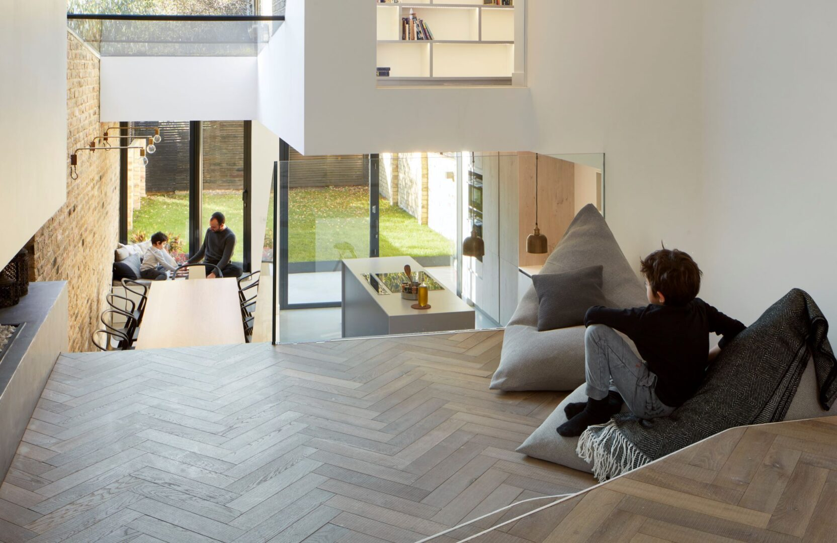 Tate bute herringbone floor with beanbag looking into kitchen by scenario architecture image by M Clayton 3