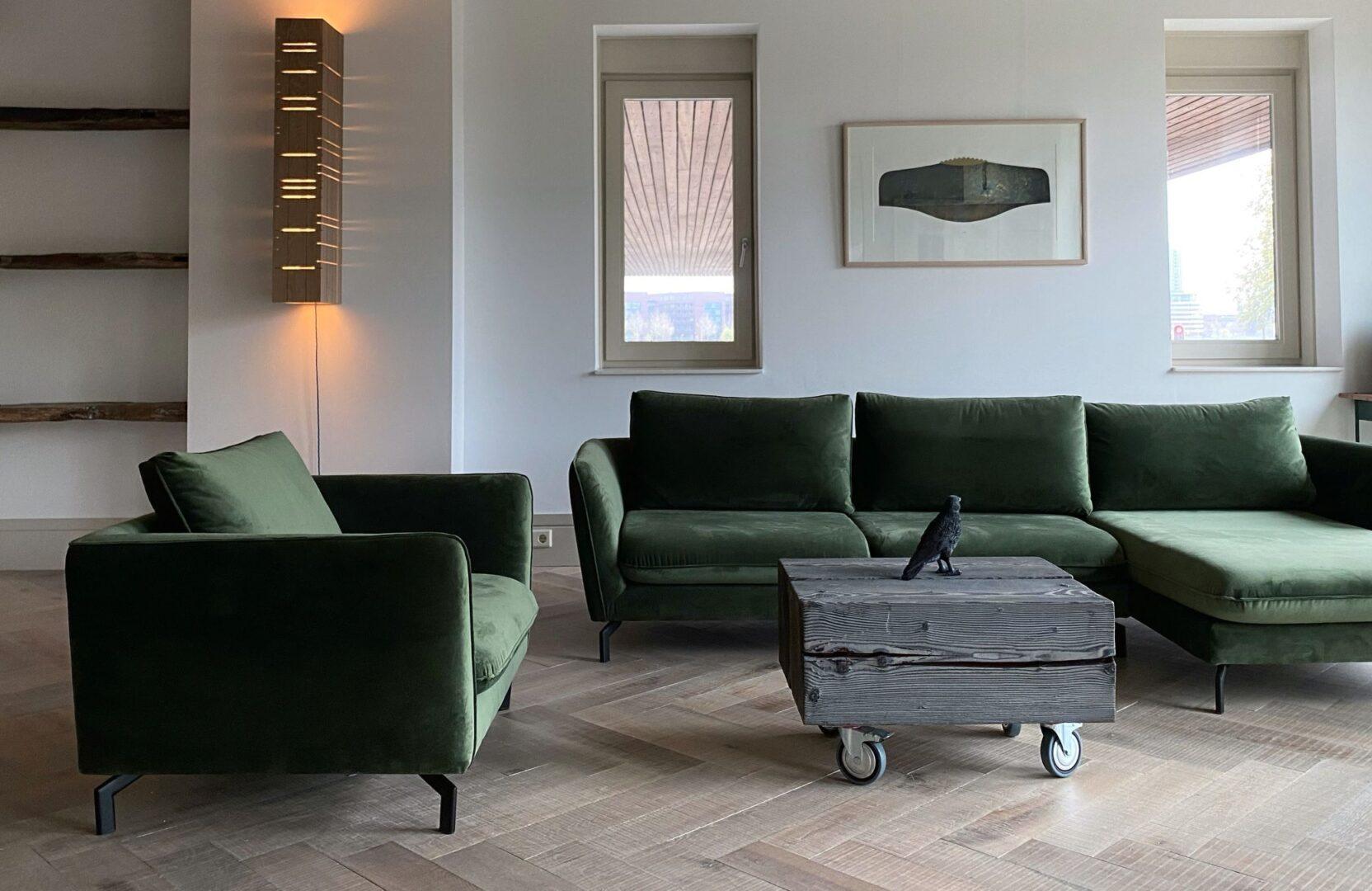 Tate bute herringbone floor with green sofa 3a